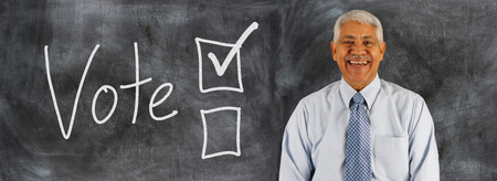 voting: Old man with voting boxes displayed on a chalk board