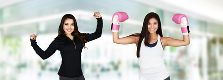 female boxer: Young female boxer with gloves working out