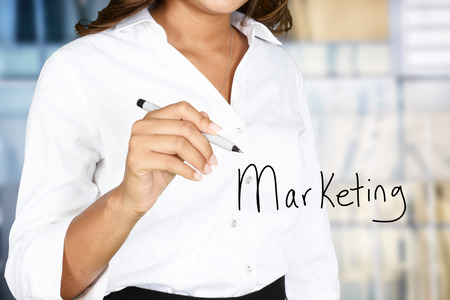 business marketing: Woman who is doing marketing work for a business Stock Photo