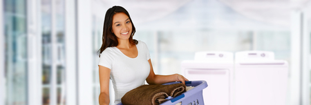 clean home: Woman doing laundry in her new home