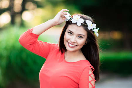 girls youth: Happy young woman who is standing outside in summer