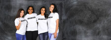 volunteering: Group of young women who are volunteering for a project