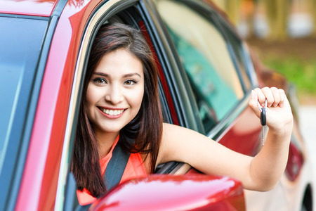 drivers seat: Woman holding up keys to her new car Stock Photo