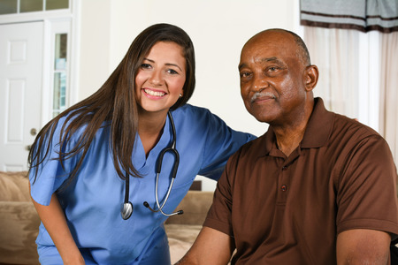 Health care worker helping an elderly patient