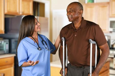 Health care worker helping an elderly patient Zdjęcie Seryjne - 62452162