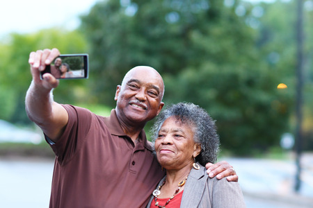 senior african: Elderly African American Man and woman posing together