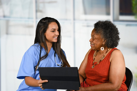 health care: Health care worker helping an elderly woman