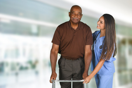 Health care worker helping an elderly patient Stock Photo - 62452285
