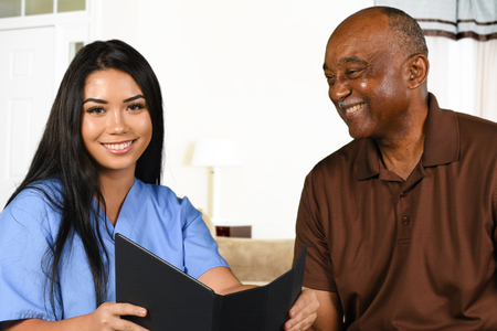 Nurse who is working her shift taking care of a patient