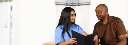 Nurse who is working her shift taking care of a patient Stock Photo - 65416495