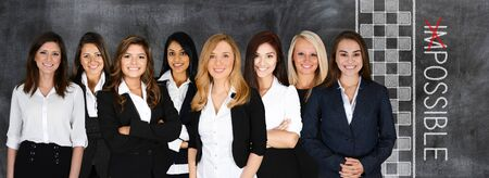 Group of businesswomen working together as a team photo