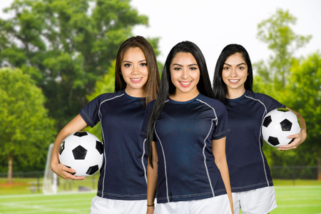A soccer team playing a game outside Stock Photo
