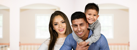 Happy young couple who are standing with their son photo