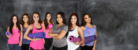 Group of young women doing a yoga class together photo
