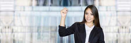 Confident businesswoman who is writing in the air Stock Photo
