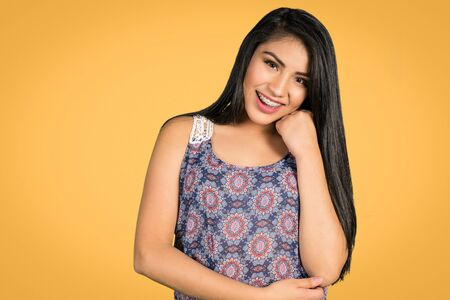 Happy hispanic girl posing on a colorful background Stock Photo