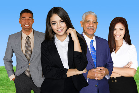 Group of businessmen and women working together photo