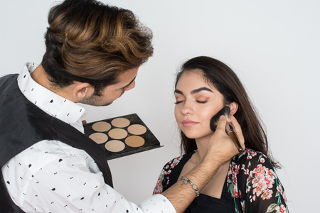 Young woman having her makeup applied by a professional Stok Fotoğraf