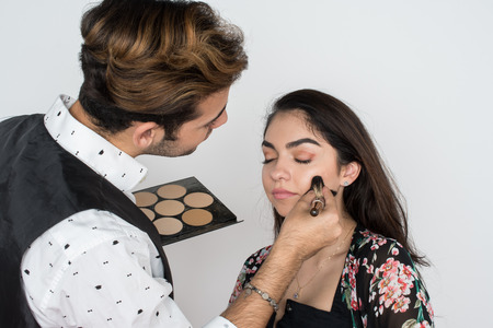Young woman having her makeup applied by a professional Stock fotó