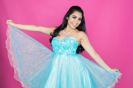 Teen girl wearing a dress for dance