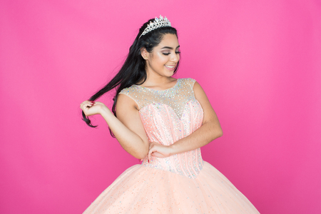 Teen hispanic girl competing in a beauty pageant Stock Photo
