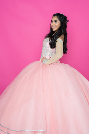 Teenage hispanic girl attending a dance in nice dress Stock Photo