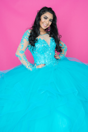 Teenage hispanic girl attending a dance in nice dress Stock Photo