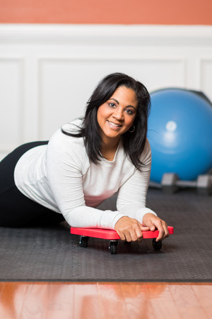 Woman working out in a gym at home Stock Photo