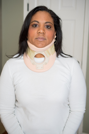 Woman with an injured neck recovering at home Stock Photo