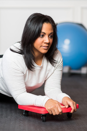 Woman working out in a gym at home Stock Photo - 95197350