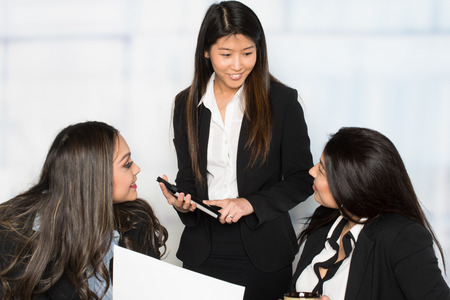 Group of businesswomen working together in an office 免版税图像