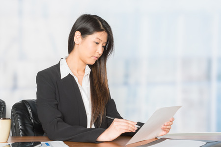 A woman who is working at a place of business Stock Photo