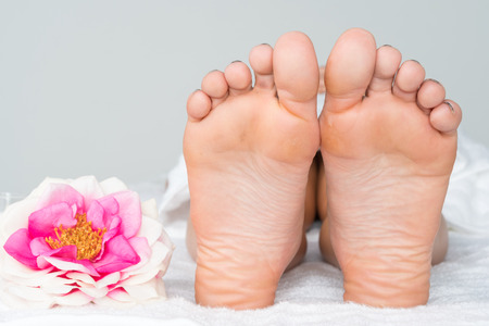 Woman getting a foot massage in the spa