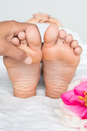 Woman getting a foot massage in the spa Stock Photo - 99909850
