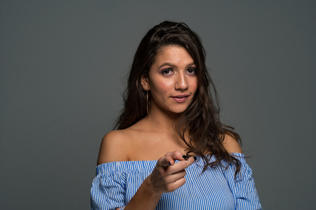 Beautiful hispanic mom posing for a portrait