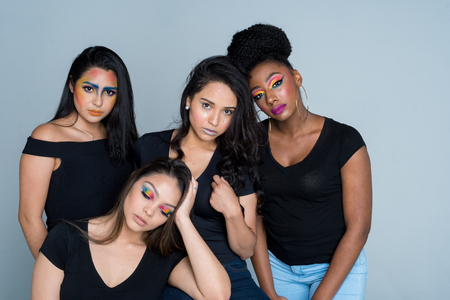 A group of fashion models posing at a photo shoot