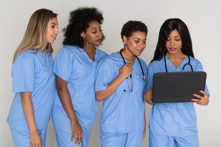 Large group of female nurses working together Stock Photo
