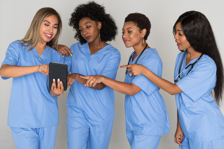Large group of female nurses working together 写真素材