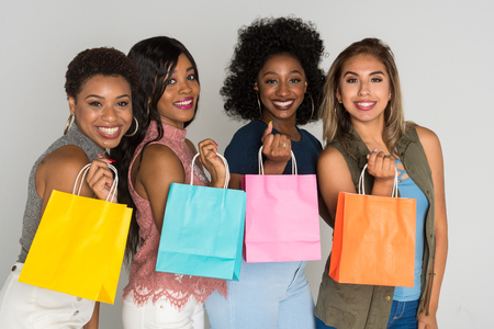 Group of four female minority friends spending time together Stockfoto