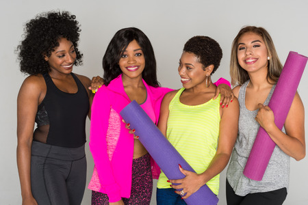 Group of fit minority women working out