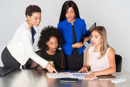Group of businesswomen working together in an office Stock Photo