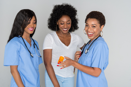 African American nurses working with a patient
