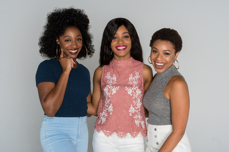 Group of three young african american friends smiling 写真素材