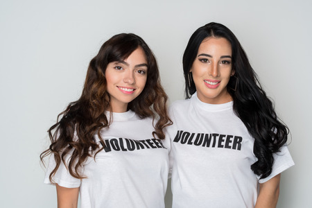 Two women who are volunteering to help a cause 写真素材