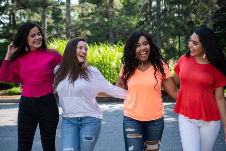 Group of four teenage female friends of different races