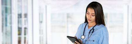 Young hispanic female nurse working in a hospital Stock Photo