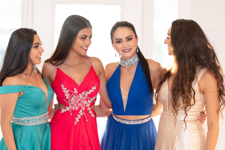 A group of teenage girls going to their prom dance Фото со стока