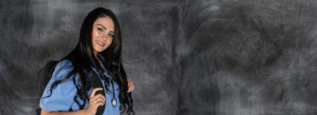Female nursing student on a challkboard background Stock Photo