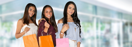 Three hispanic friends on a shopping trip together Stock Photo