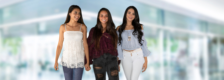 Group of three happy hispanic teenage friends Stock Photo